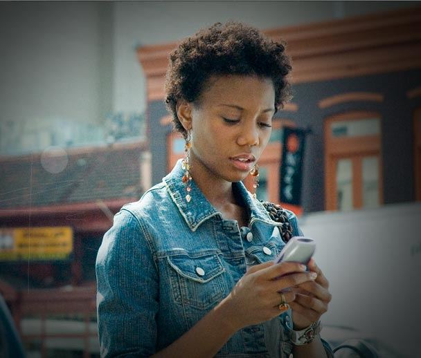 African American woman looking at her phone